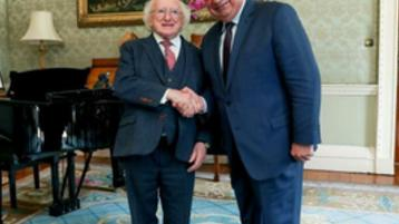 President Michael D. Higgins greets Gérard Larcher, president of the Senate of France, at Aras an Uachtarain